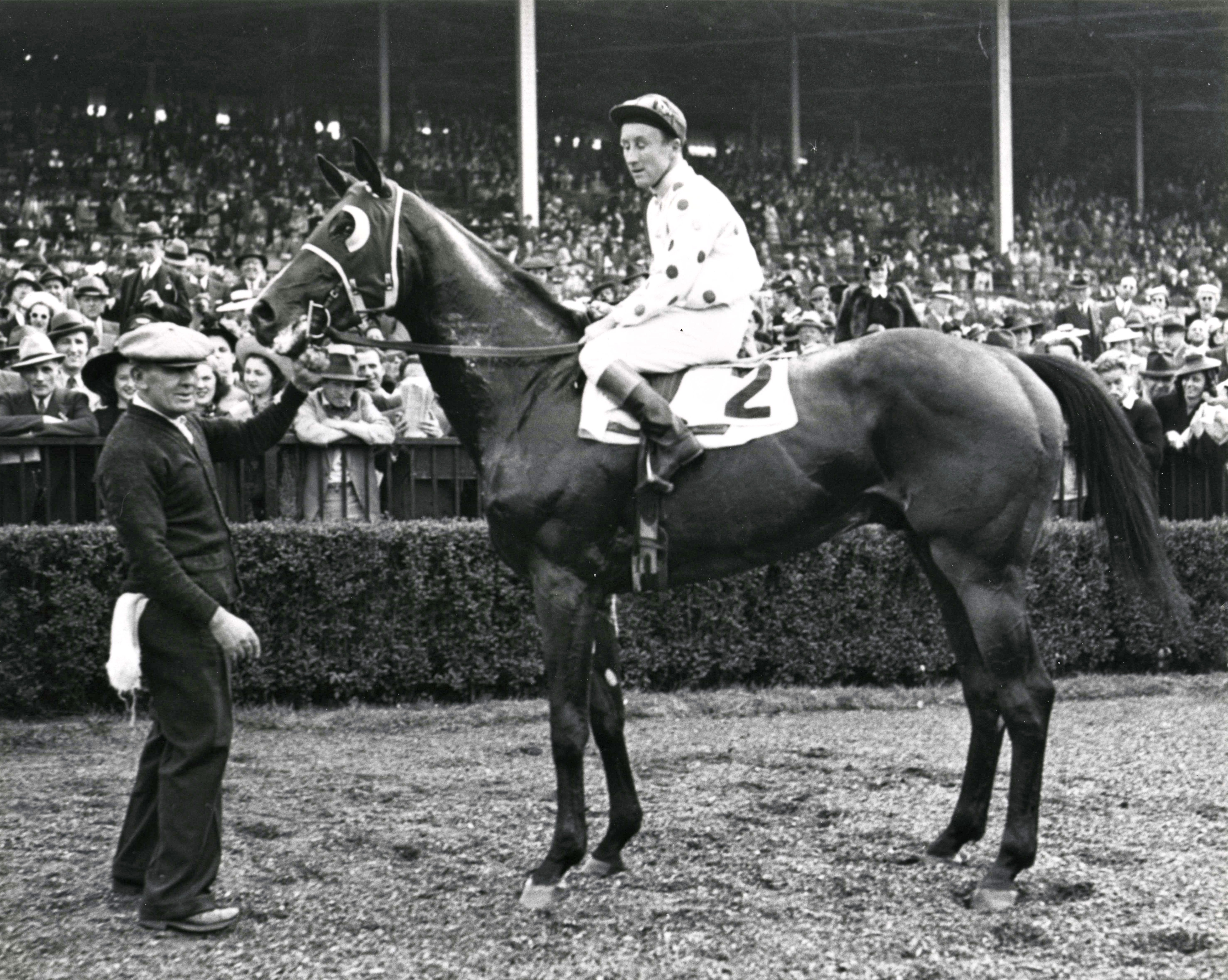 Johnstown (James Stout up) in the winner's circle (Keeneland Library Morgan Collection/Museum Collection)