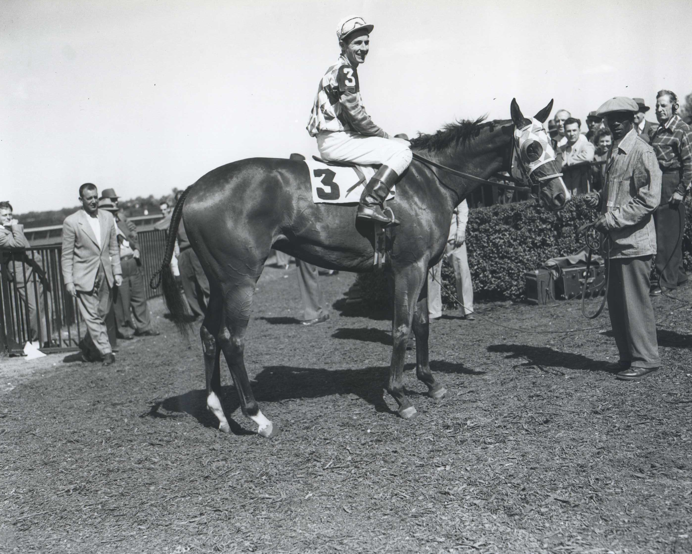 Bed o' Roses (Eric Guerin up) in the winner's circle for the 1949 National Stallion Stakes at Belmont Park (Keeneland Library Morgan Collection/Museum Collection)
