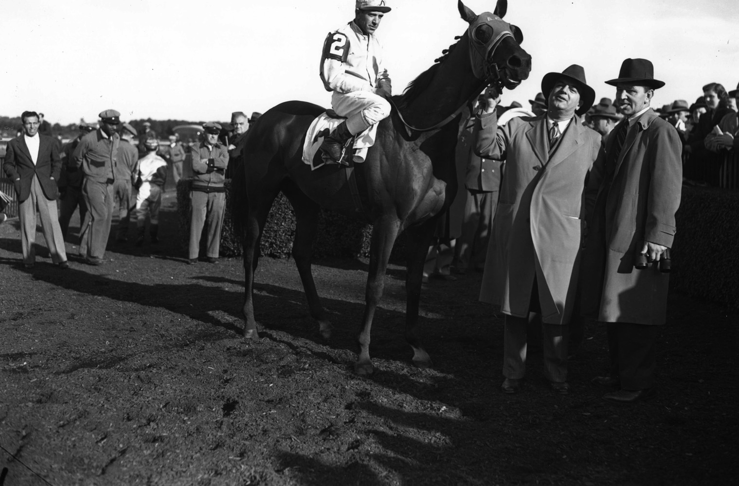 Alsab with George Woolf up in the winner's circle (Keeneland Library Morgan Collection/Museum Collection)