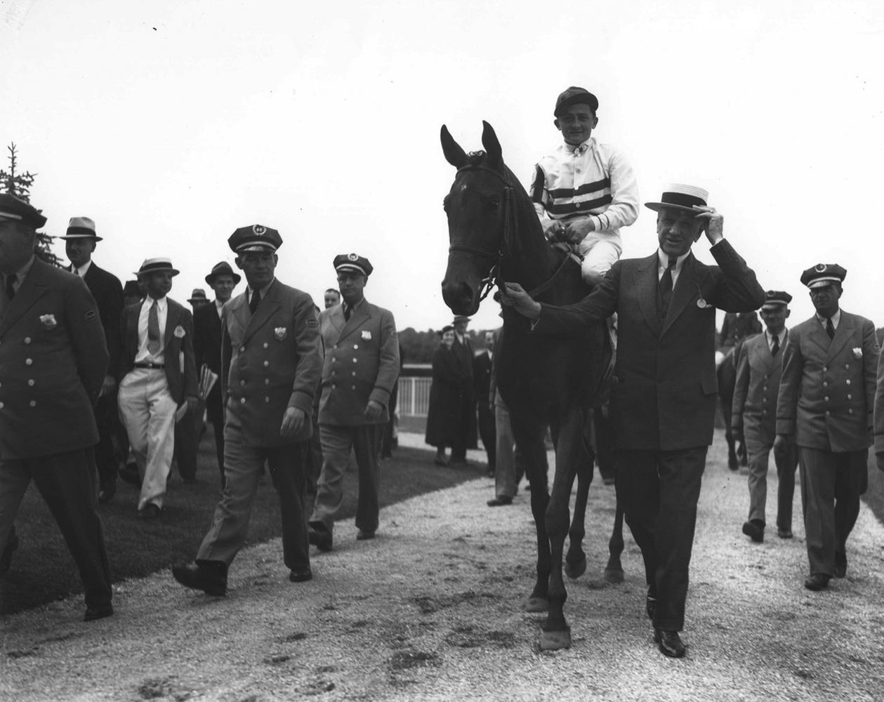 Black Helen entering the winner's circle after winning the 1935 Coaching Club American Oaks (Keeneland Library Morgan Collection/Museum Collection)