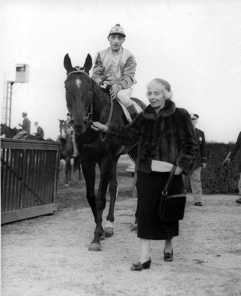 Bold Ruler (Eddie Arcaro up) being led to the winner's circle by owner Gladys Mills Phipps (Museum Collection)