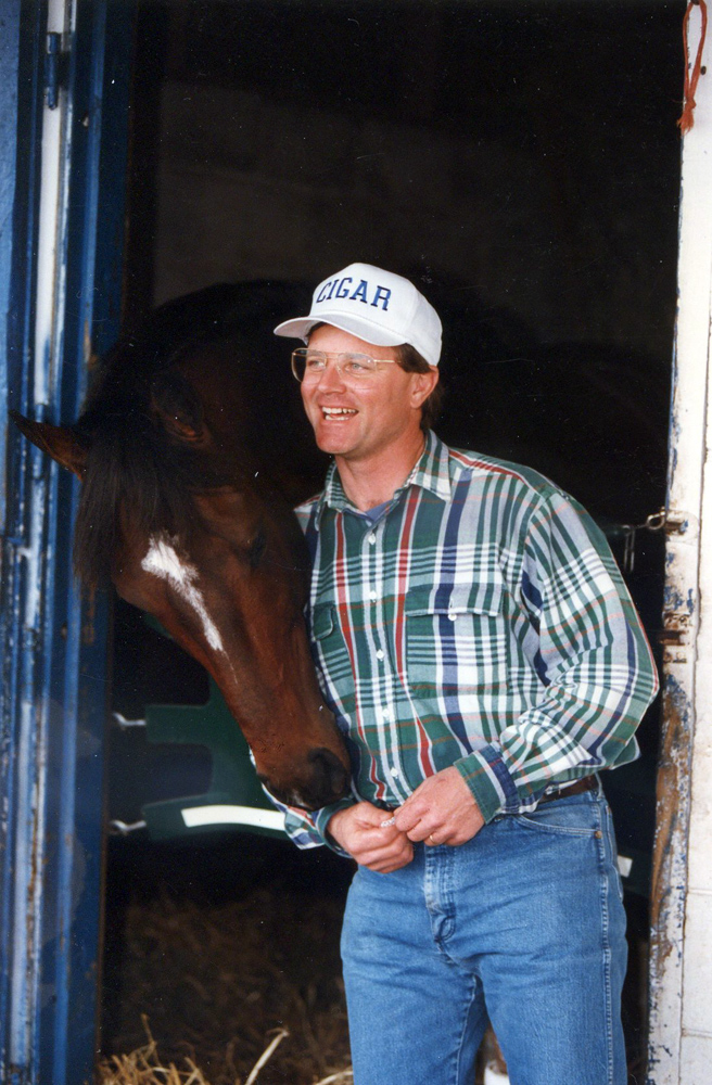 Cigar with trainer Bill Mott at Payson Park, February 1996 (Barbara D. Livingston/Museum Collection)
