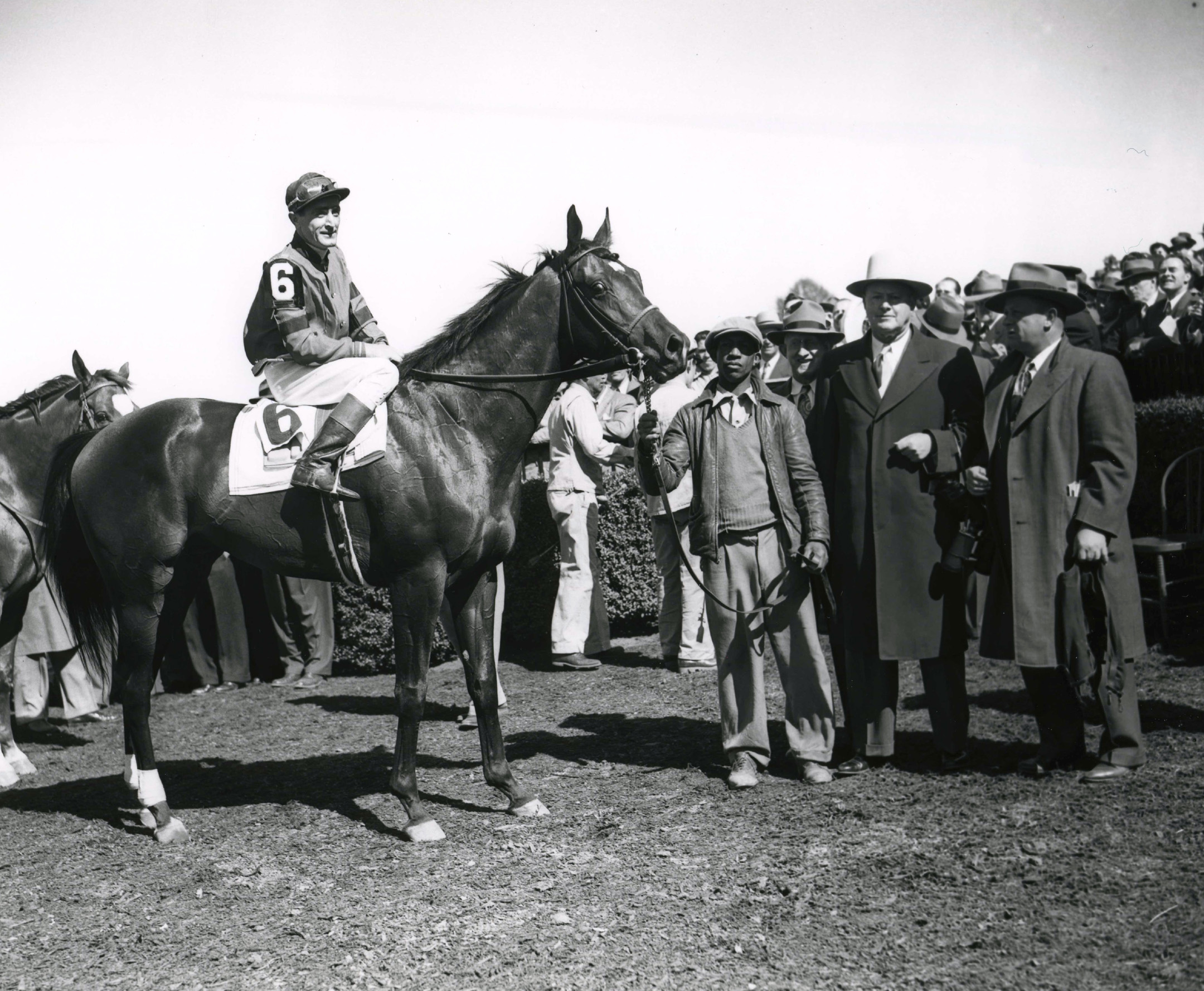 Coaltown in the winner's circle with Hall of Fame trainers Ben and Jimmy Jones for the 1948 Swift Stakes at Belmont Park (Keeneland Library Morgan Collection/Museum Collection)