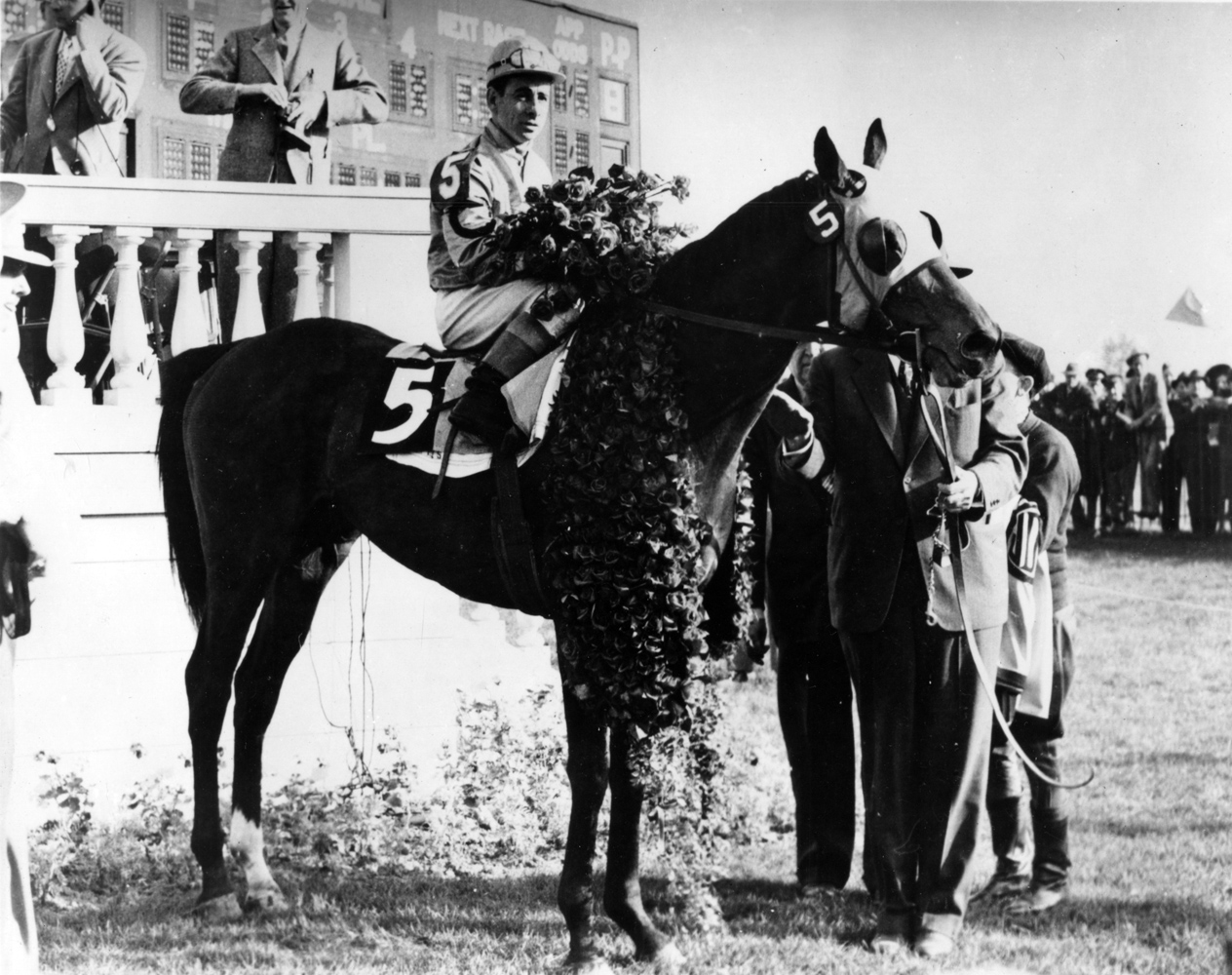 Count Fleet and Johnny Longden in the winner's circle for the 1943 Kentucky Derby (Churchill Downs Inc./Kinetic Corp. /Museum Collection)