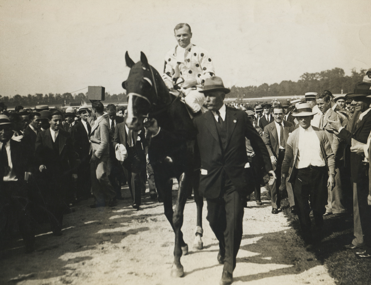 Owner William Woodward, Jr. leading in Gallant Fox (Earl Sande up) after winning the 1930 Lawrence Realization at Belmont Park (Museum Collection)