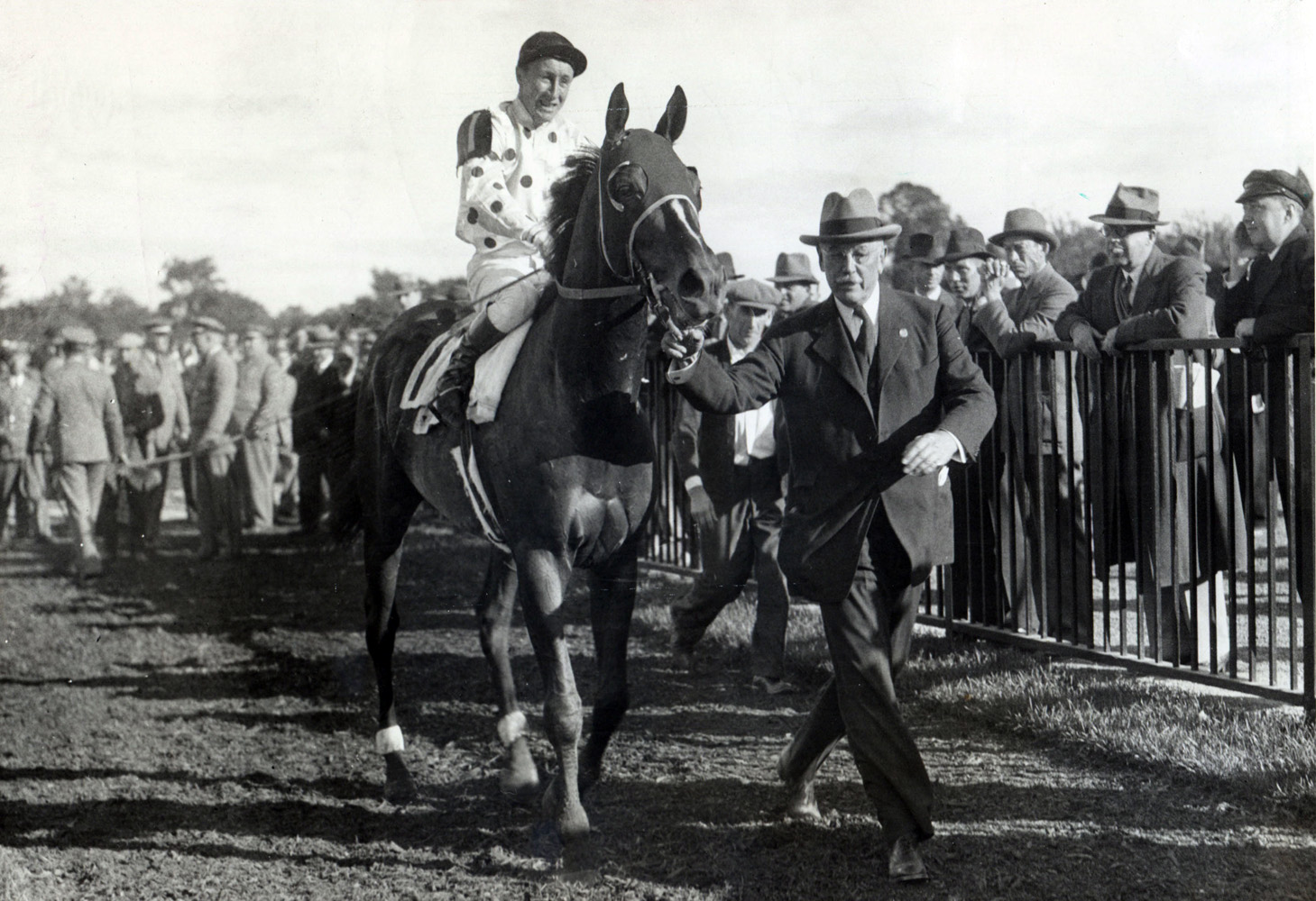 Granville (James Stout up) being led in by owner William Woodward, Jr. after winning the 1936 Lawrence Realization at Belmont Park, his final race (Museum Collection)