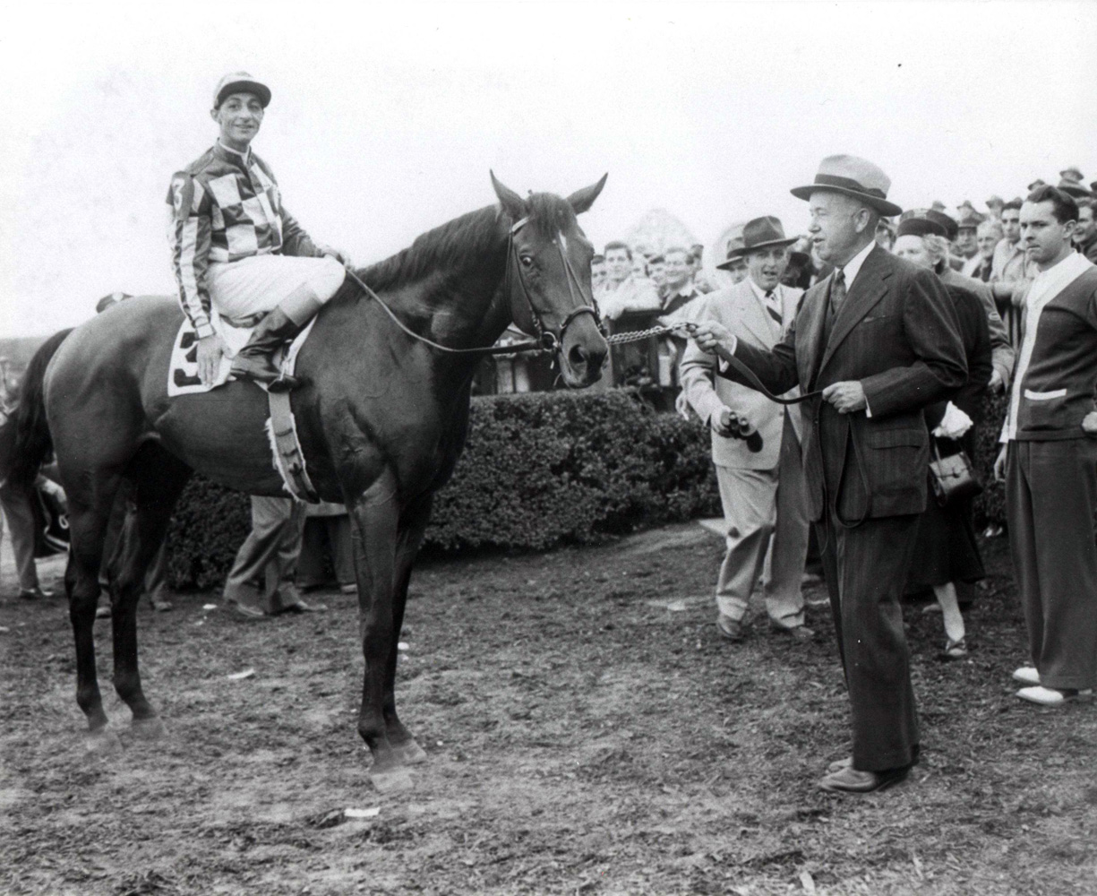 Hill Prince (Eddie Arcaro up) and owner Christopher Chenery in the winner's circle for the 1950 Jockey Club Gold Cup (The BloodHorse/Museum Collection)
