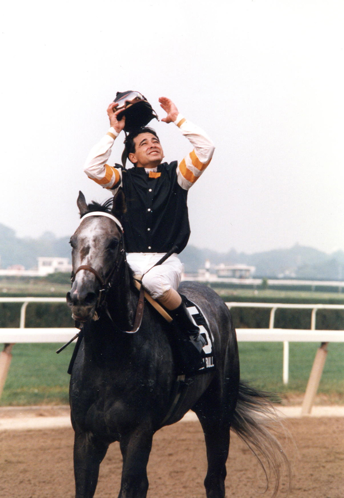 Holy Bull with Mike Smith up celebrating after winning the 1994 Woodward at Belmont Park (Barbara Ann Giove Coletta/Museum Collection)
