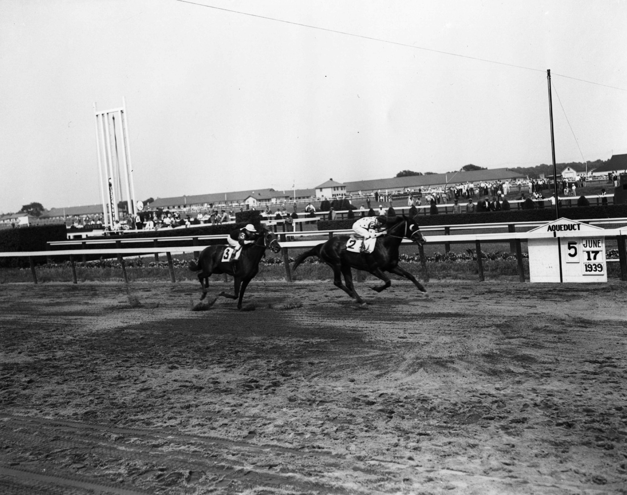Johnstown (James Stout up) winning the 1939 Dwyer Stakes at Aqueduct (Keeneland Library Morgan Collection/Museum Collection)