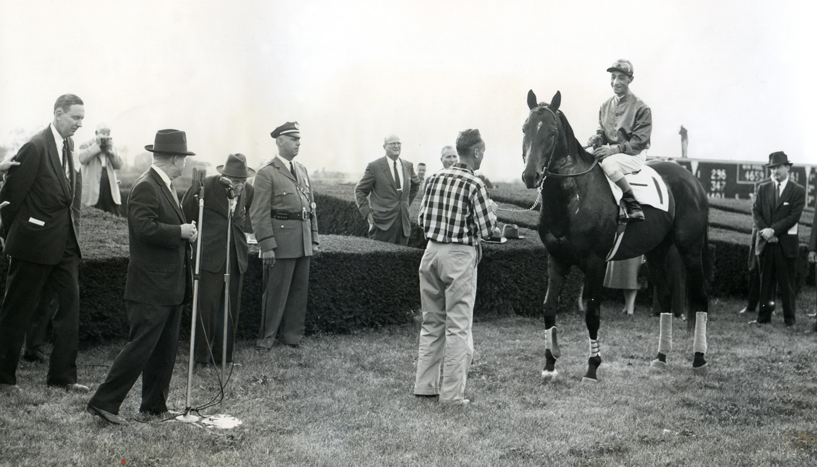 """Nashua's farewell appearance at Keeneland with Eddie Arcaro up and trainer """"Sunny Jim"""" Fitzsimmons in attendance, October 1956 (Museum Collection)"""
