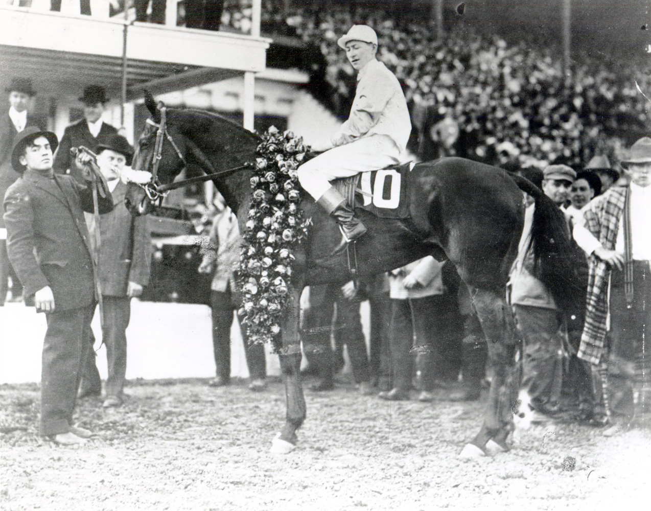 Old Rosebud (John McCabe up) in the winner's circle for the 1914 Kentucky Derby (Churchill Downs Inc./Kinetic Corp. /Museum Collection)