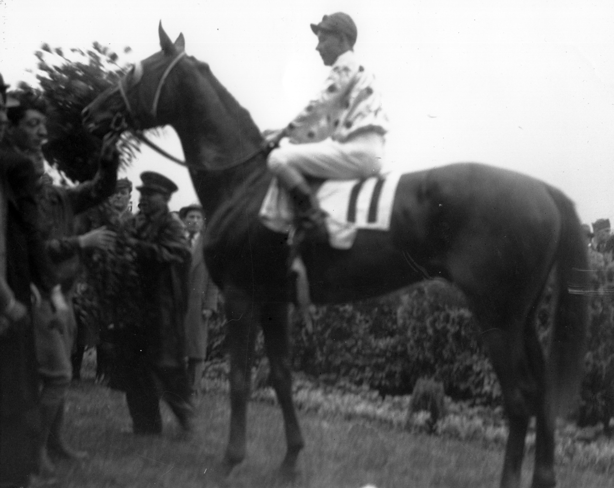 Omaha (Willie Saunders up) in the winner's circle for the 1935 Kentucky Derby (Churchill Downs Inc./Kinetic Corp. /Museum Collection)