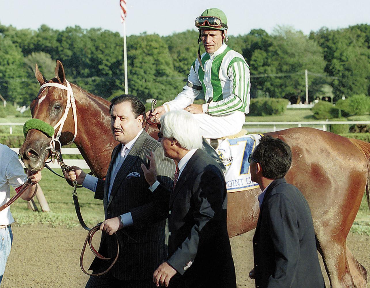 Point Given (Gary Stevens up) entering the winner's circle for the 2001 Travers (Tom Killips)
