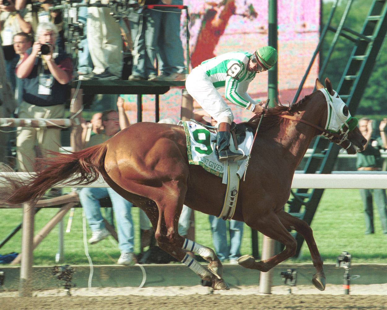 Looking back for the competition, Point Given's rider (Gary Stevens) discovers they won the Belmont by over 12 lengths (NYRA)