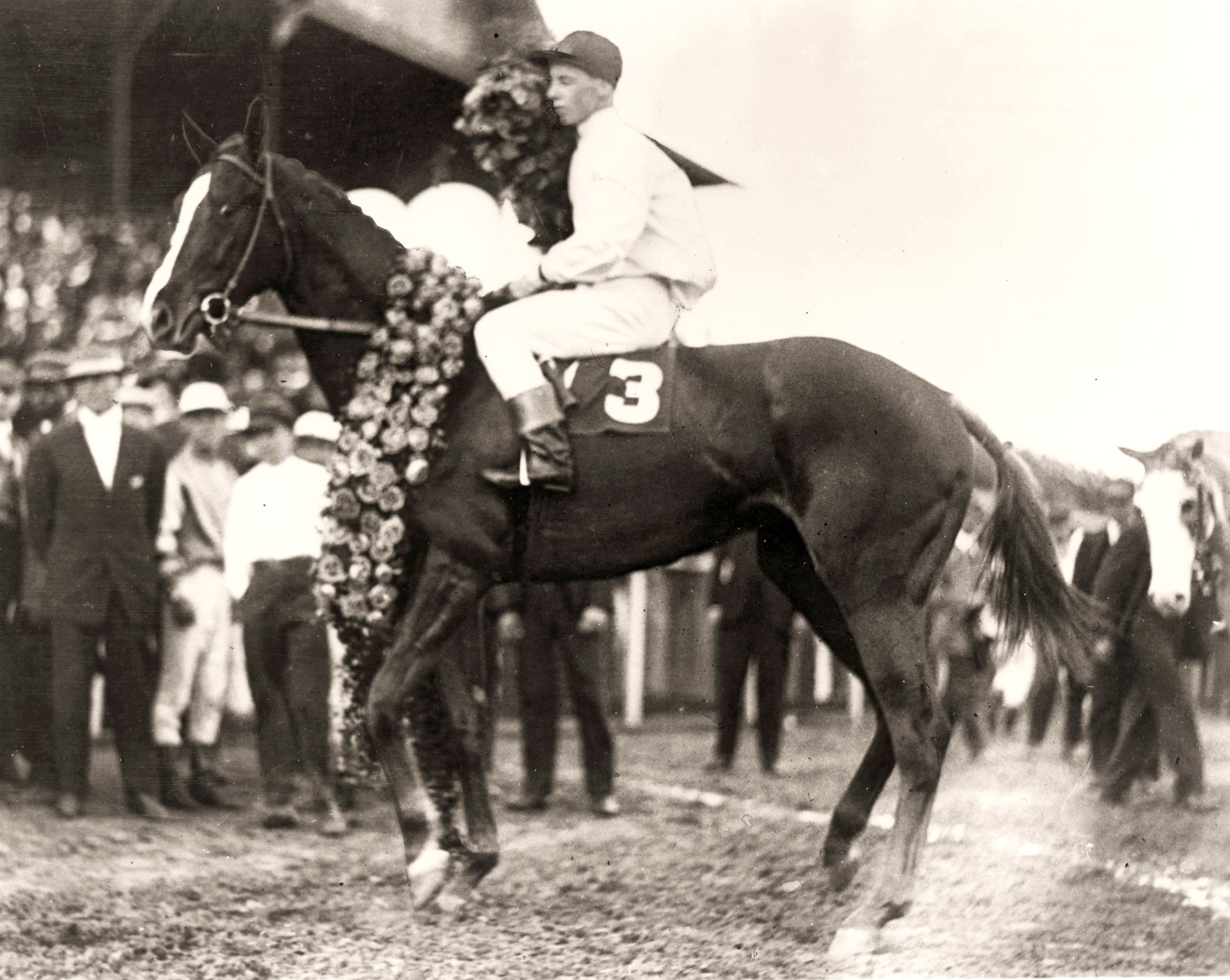 Regret (Joe Notter up) in the winner's circle after the 1915 Kentucky Derby (Churchill Downs Inc./Museum Collection)