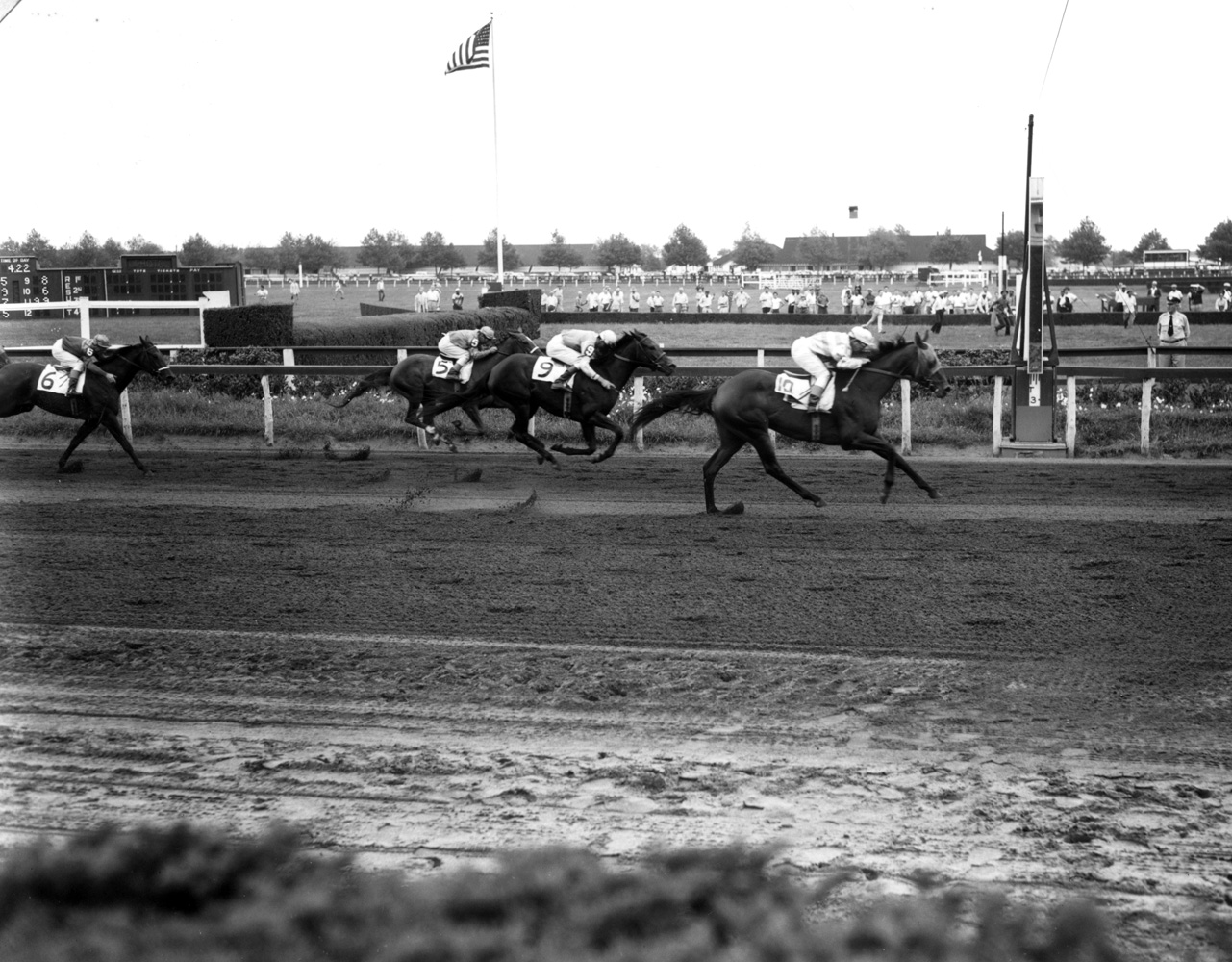 Searching (Conn McCreary up) winning the 1955 Vagrancy Handicap at Aqueduct (Keeneland Library Morgan Collection/Museum Collection)