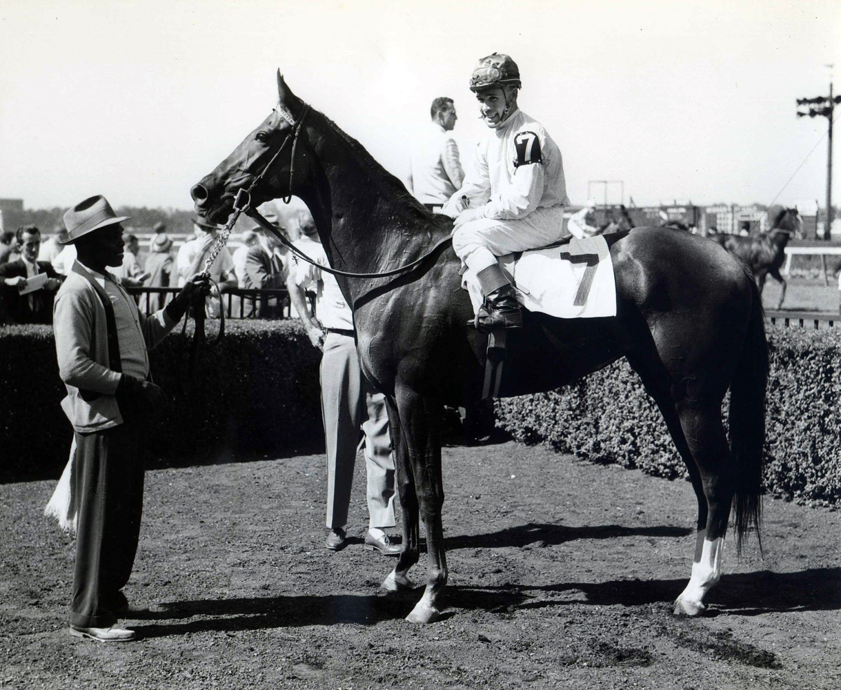 Silver Spoon (Eldon Nelson up) in the winner's circle at Belmont Park for her very first career start, September 1958 (Mike Sirico/Museum Collection)