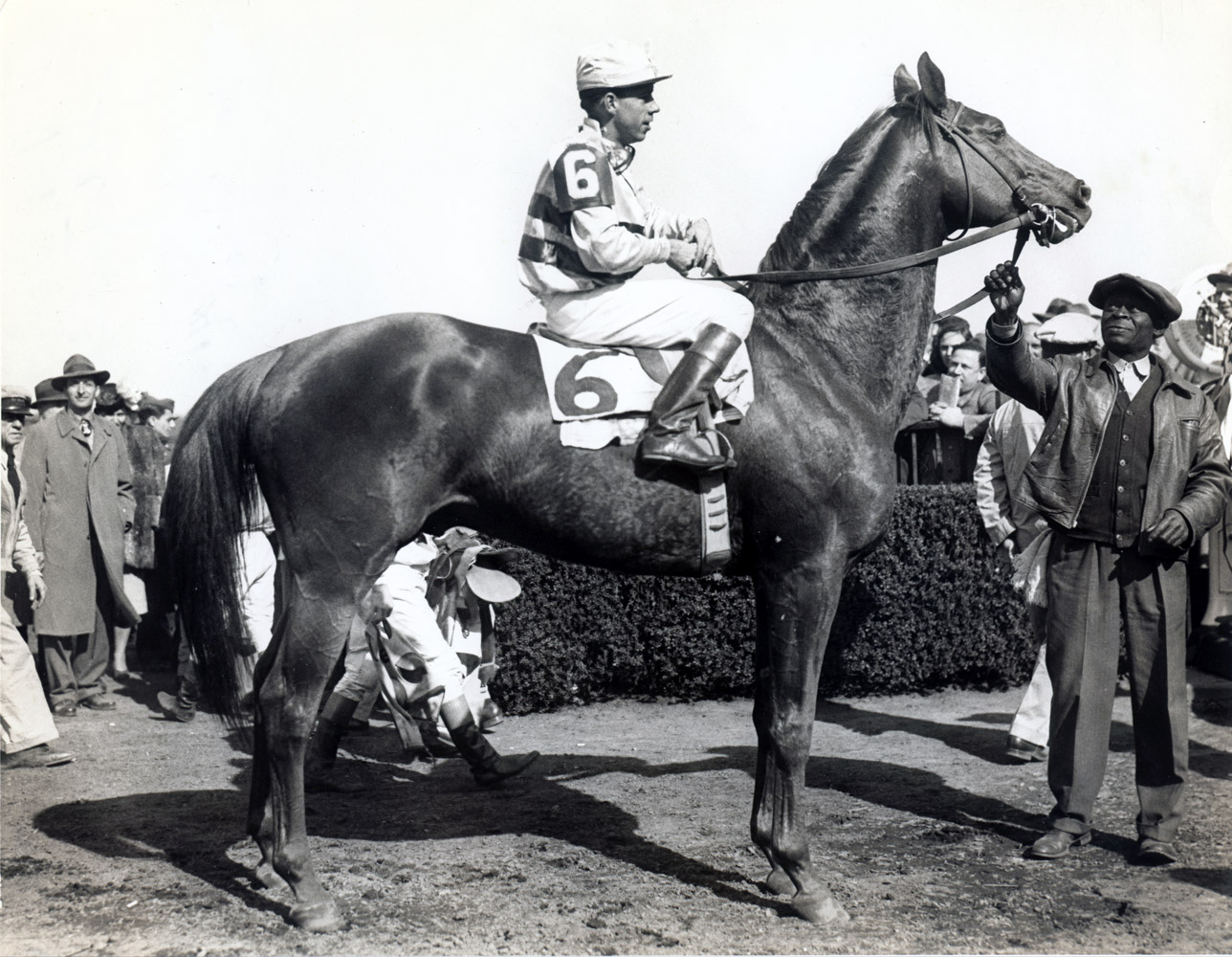 Stymie in the winner's circle with Basil James up (Museum Collection)