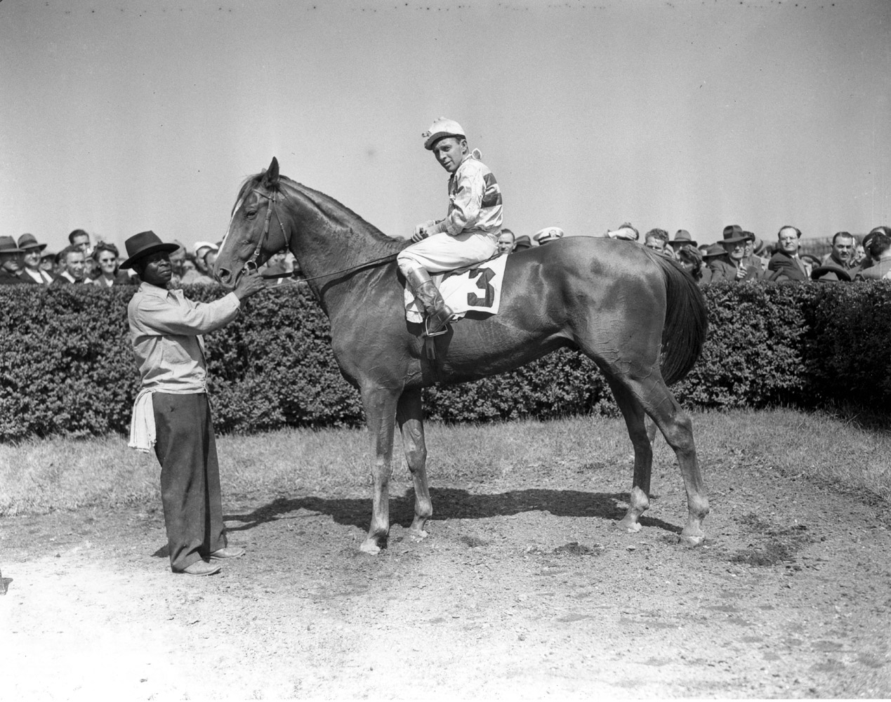 Stymie (John Adams up) in the winner's circle for the 1945 Rancocas Handicap at Jamaica, May 1945 (Keeneland Library Morgan Collection/Museum Collection)