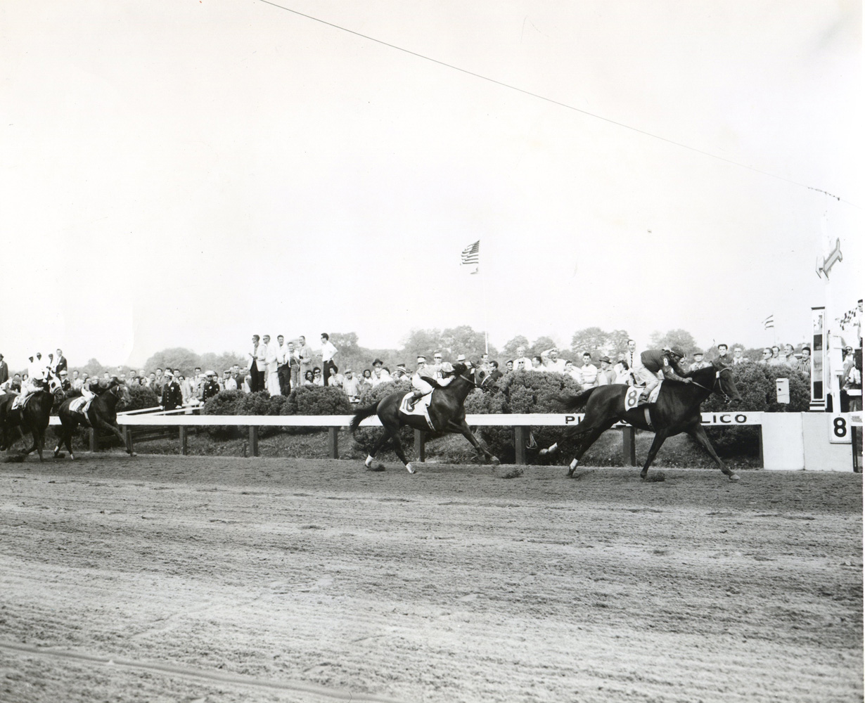 Tim Tam (Ismael Valenzuela up) winning the 1958 Preakness at Pimlico (Pimlico Photo/Jerry Frutkoff /Museum Collection)