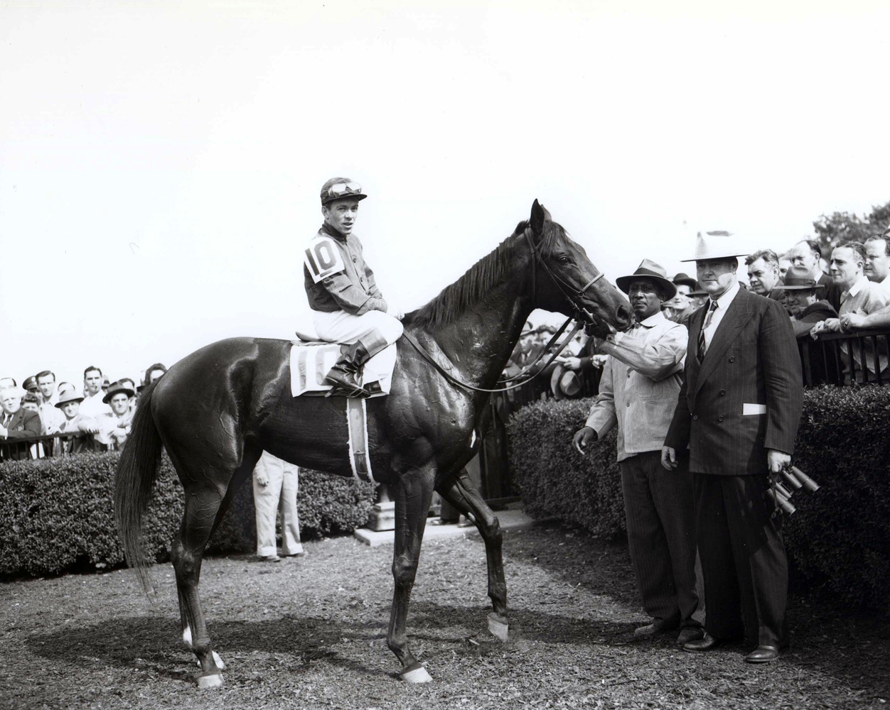 Twilight Tear (Conn McCreary up) with trainer Ben Jones in the winner's circle for the 1944 Acorn at Belmont Park (Keeneland Library Morgan Collection/Museum Collection)