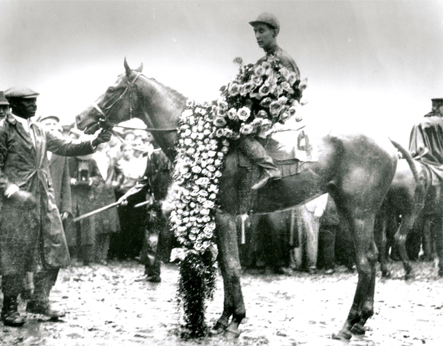 Reigh Count (Chick Lang up) in the winner's circle for the 1928 Kentucky Derby (Churchill Downs Inc./Kinetic Corp. /Museum Collection)