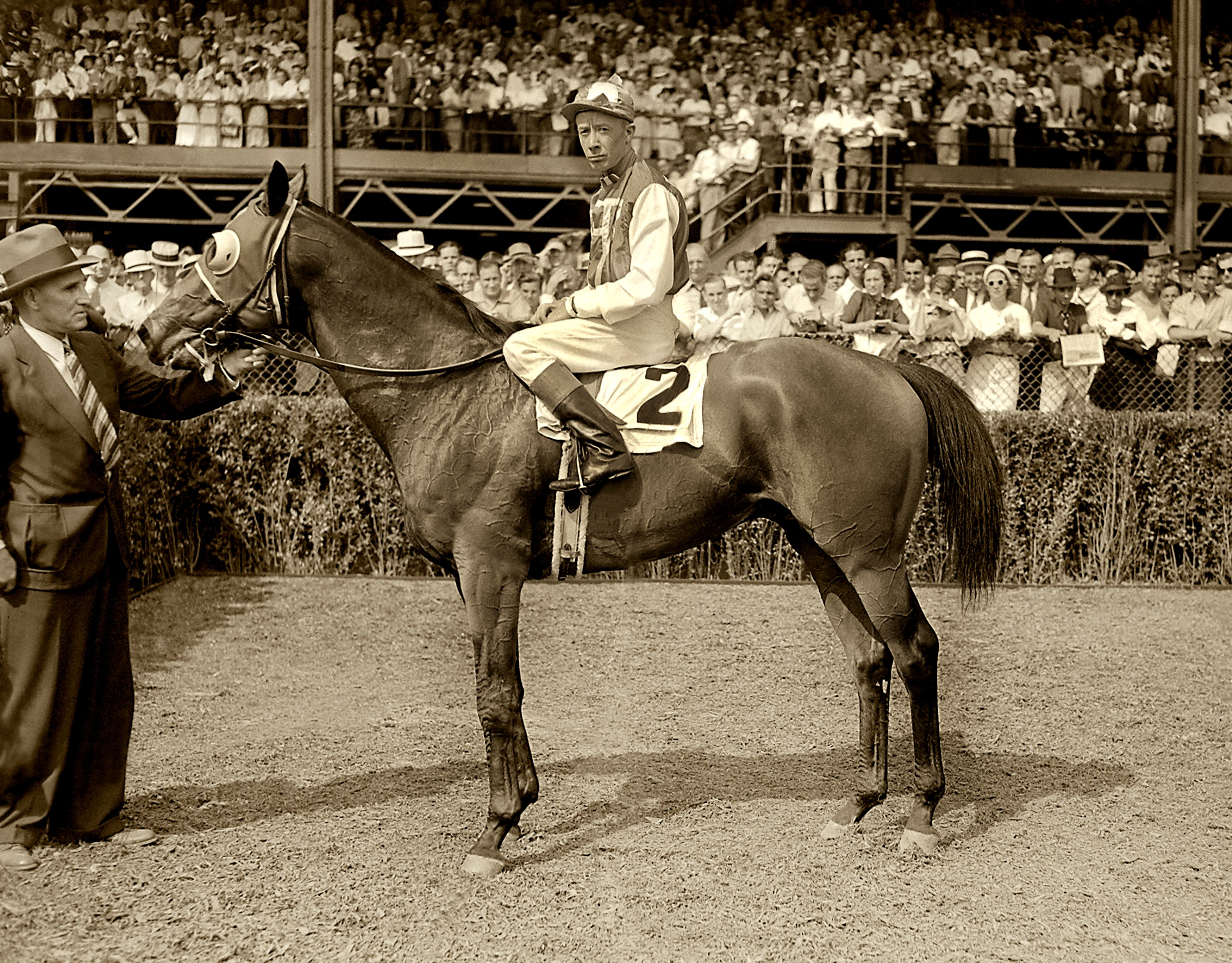 Seabiscuit (Red Pollard up) in the winner's circle with trainer Tom Smith for the 1937 Yonkers Handicap at Empire City (Keeneland Library Morgan Collection/Museum Collection)