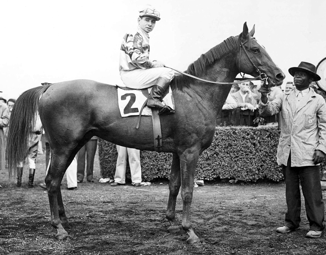 Stymie (Johnny Longden up) in the winner's circle after winning the 1945 Saratoga Cup at Belmont Park  (Bert Morgan/Museum Collection)