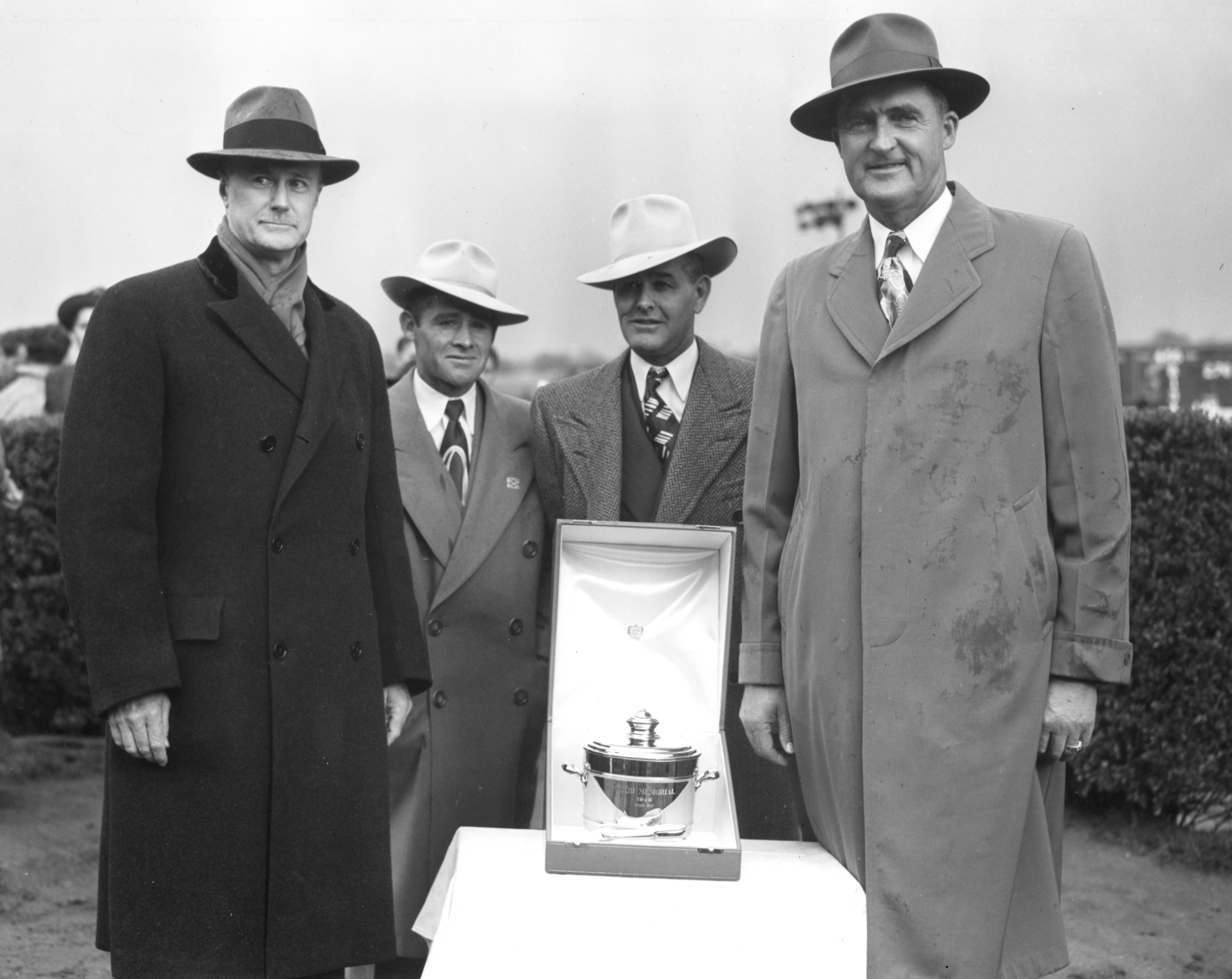 John Morris, Charles Parke, Ivan Parke, and Fred Hooper at the trophy presentation for the 1949 Wood Memorial at Jamaica (won by Olympia) (Keeneland Library Morgan Collection/Museum Collection)