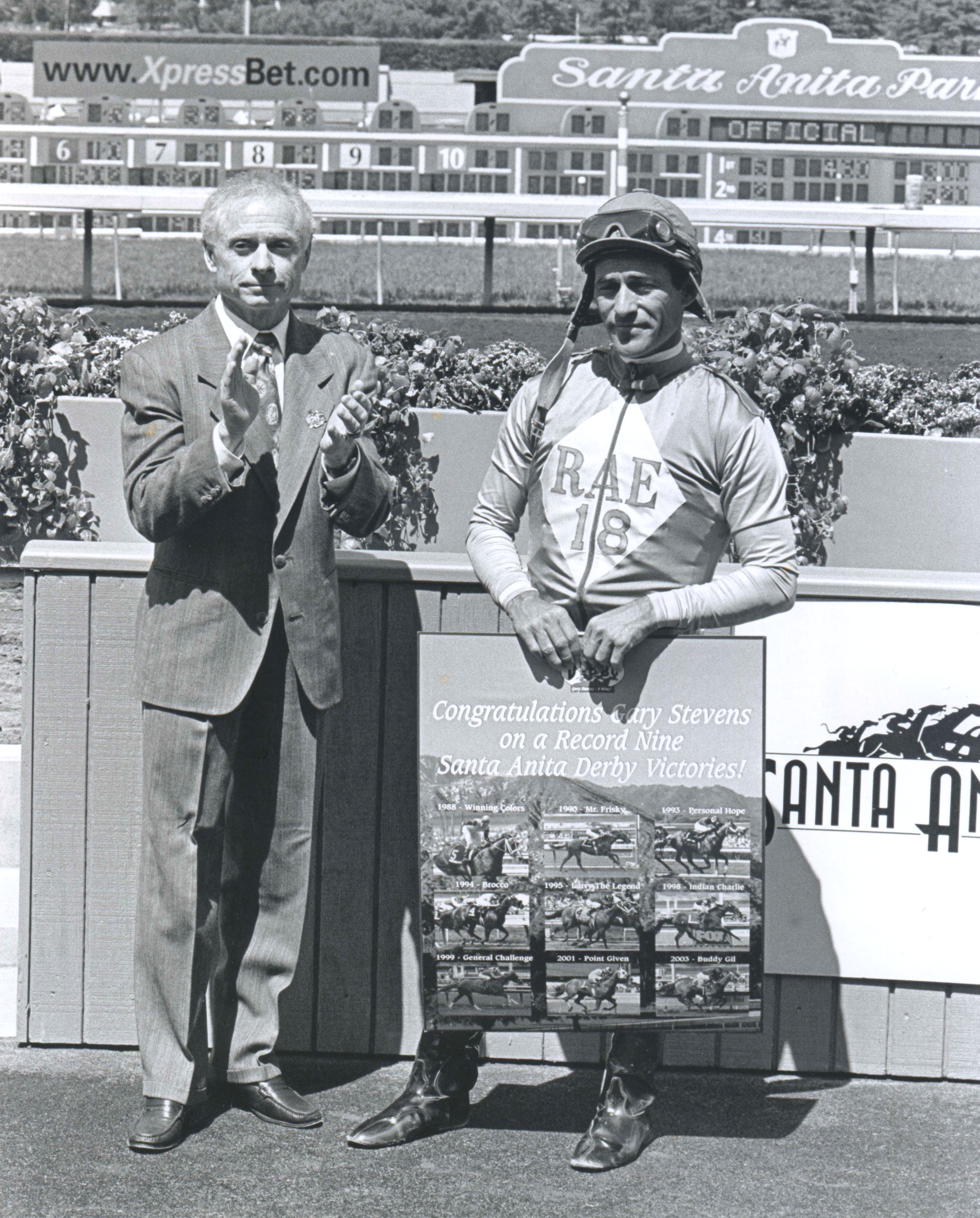 Santa Anita General Manager and Hall of Fame jockey Chris McCarron celebrates Gary Stevens record nine Santa Anita Derby victories, April 19, 2003 (Gary Stevens is seen holding a plaque  (Bill Mochon/Museum Collection)