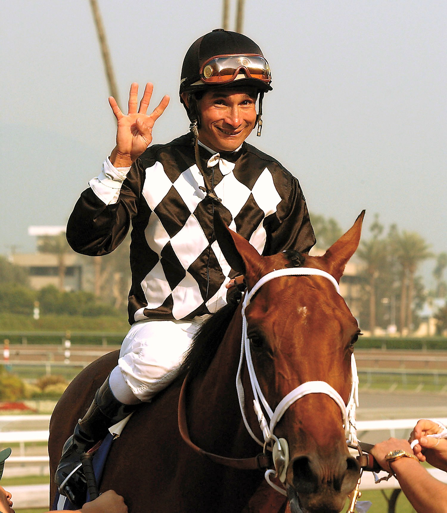 Alex Solis celebrates his 4,000th career victory in 2003 at Santa Anita (Anne Eberhardt)