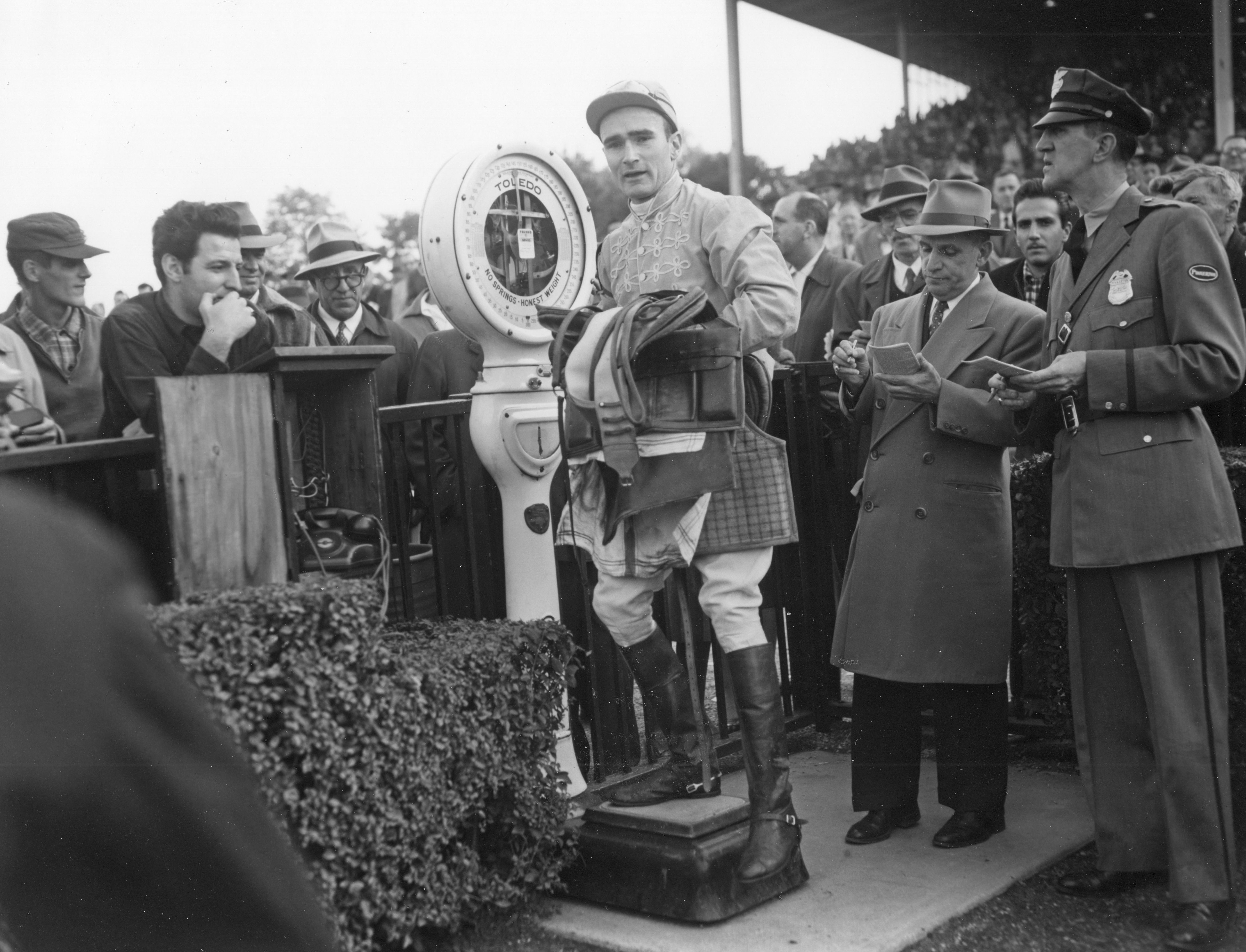Frank Dooley Adams weighing in after a race at Belmont Park, October 1955 (Keeneland Library Morgan Collection/Museum Collection)
