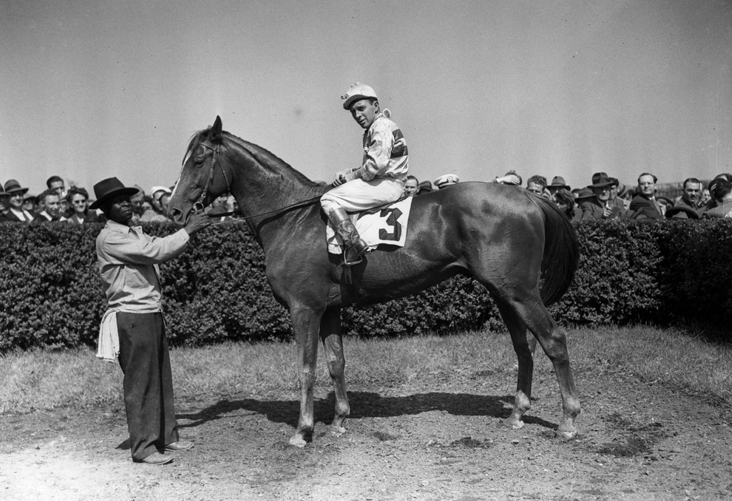 Stymie (John Adams up) in the winner's circle for a handicap event at Jamaica, May 1945 (Keeneland Library Morgan Collection/Museum Collection)