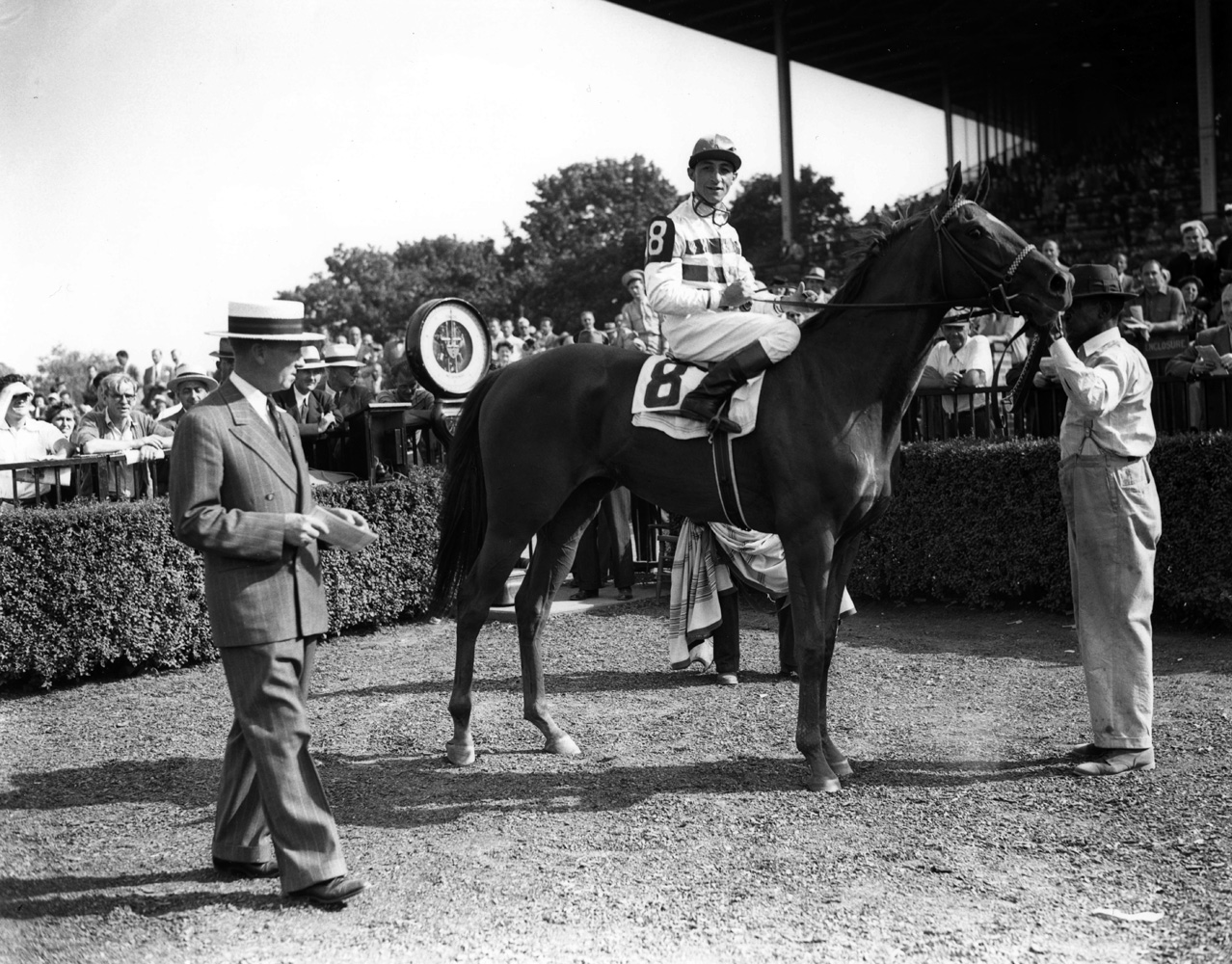 Eddie Arcaro and Busher in the winner's circle for the 1944 Adirondack at Belmont Park (Keeneland Library Morgan Collection/Museum Collection)