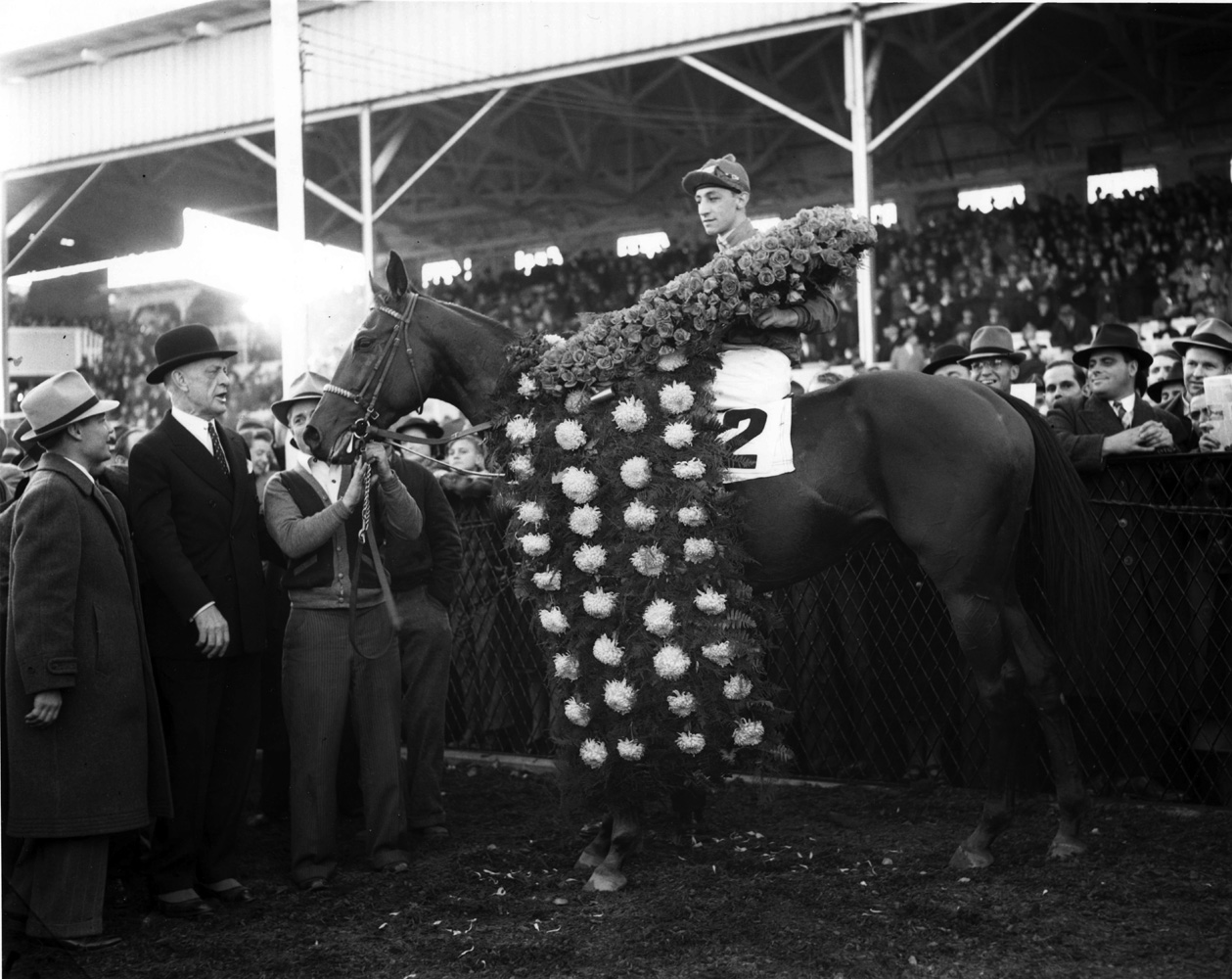 Eddie Arcaro and Challedon in the winner's circle for the 1939 Pimlico Special (Keeneland Library Morgan Collection/Museum Collection)
