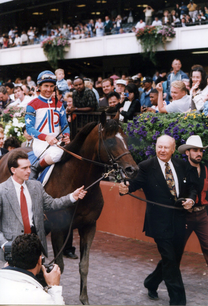 Jerry Bailey and Cigar entering the winner's circle after winning the 1995 Woodward at Belmont Park (Barbara Ann Giove Coletta/Museum Collection)