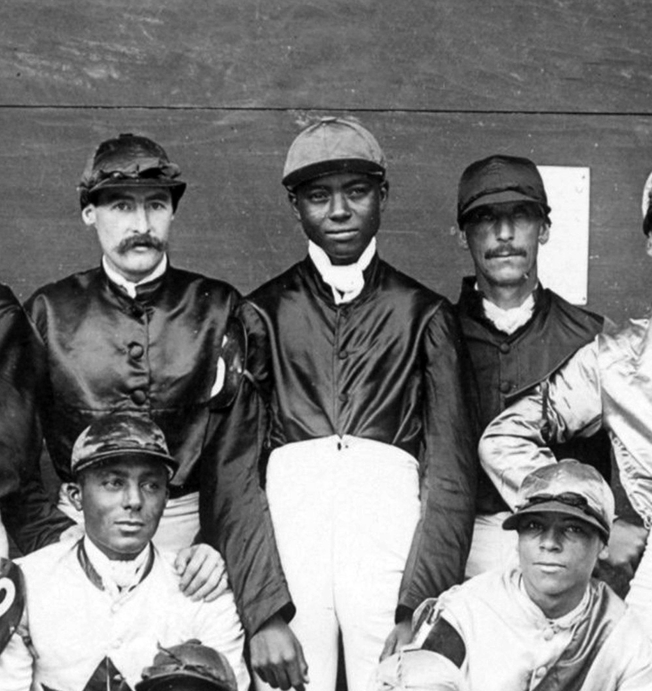"Shelby ""Pike"" Barnes (center) in a group portrait of a jockey colony (Keeneland Library Hemment Collection)"