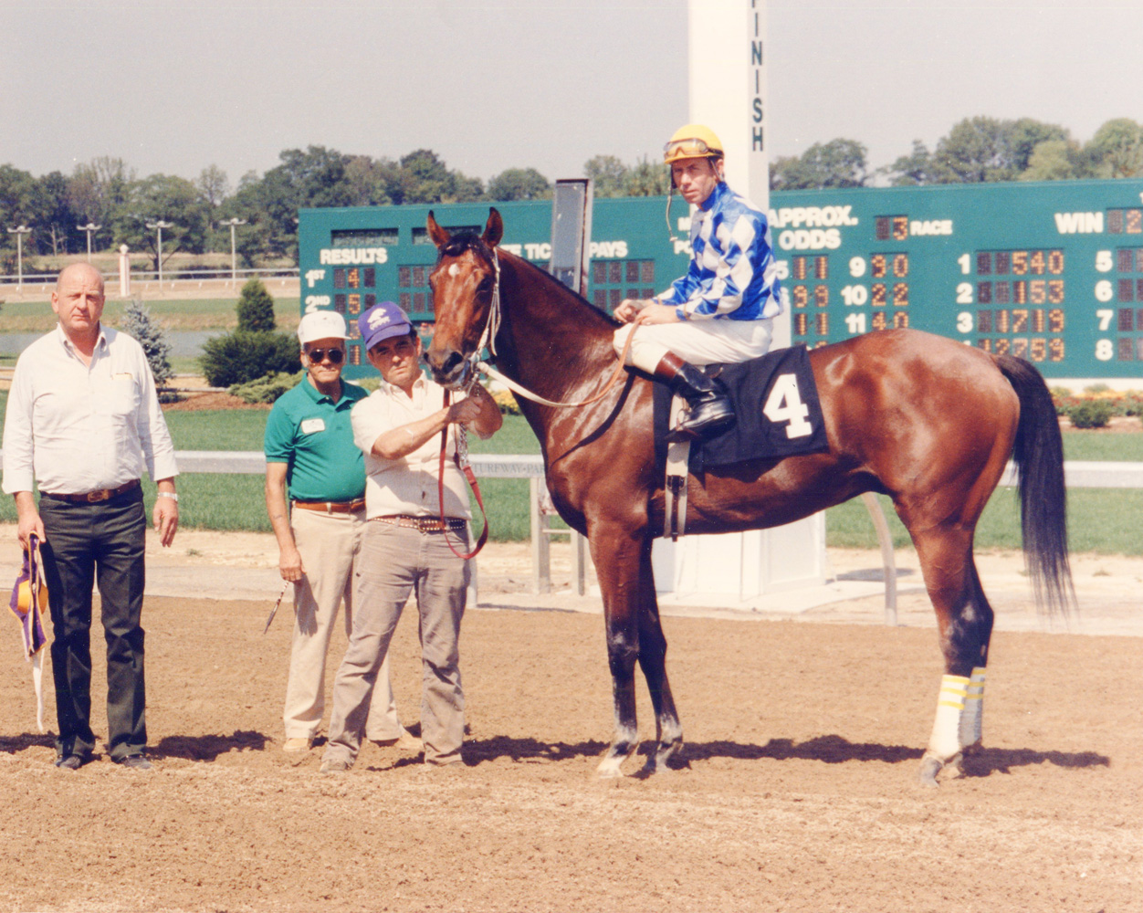 Don Brumfield and Alysheba in the winner's circle at Turfway Park (Lang Photos/Museum Collection)