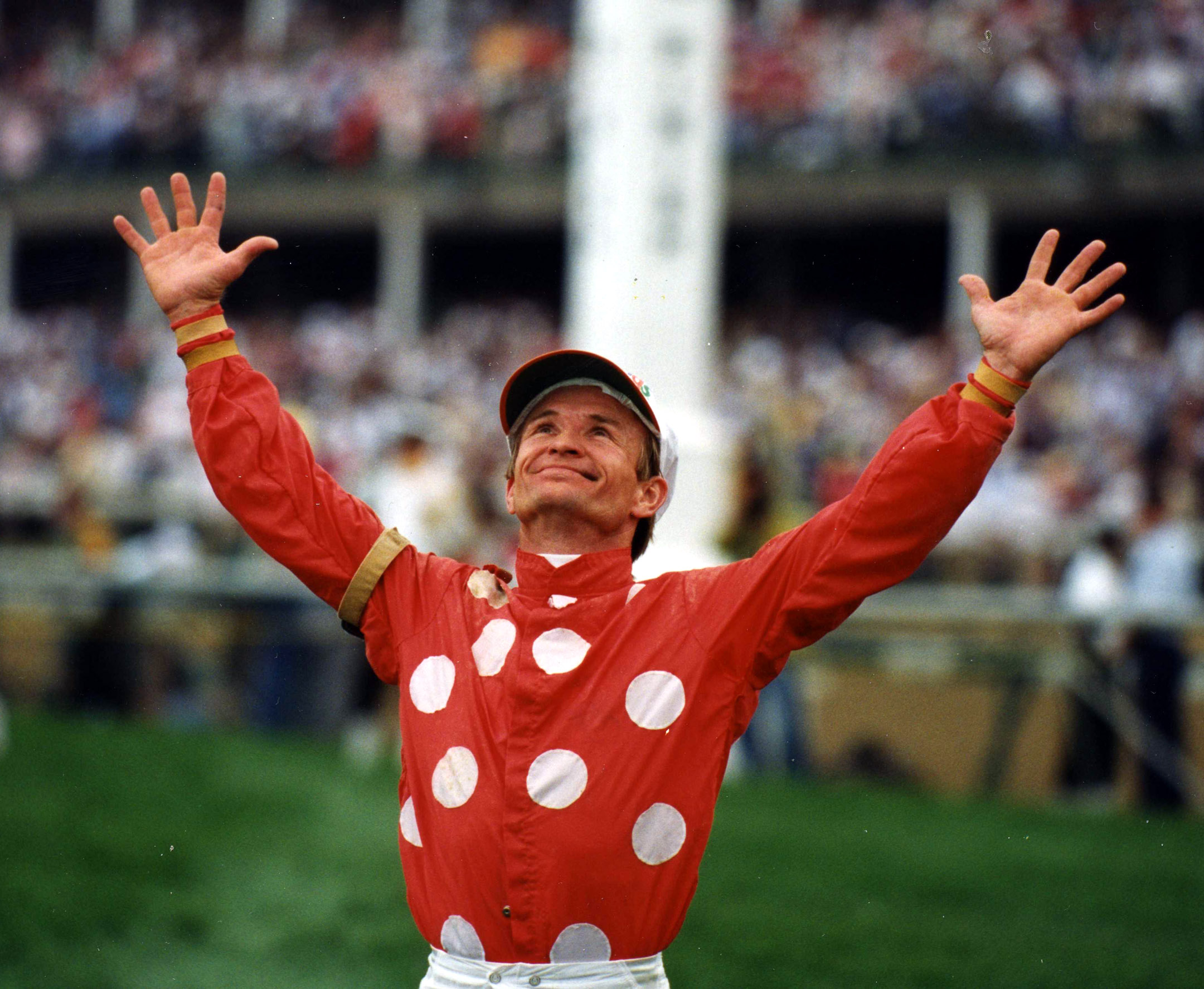 Pat Day celebrating after winning the 1992 Kentucky Derby with Lil E. Tee (Shigeki Kikkawa/Museum Collection)