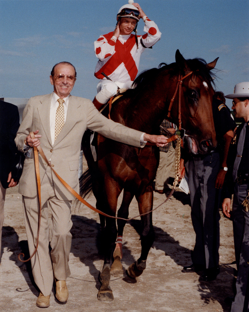 Pat Day and Danzig Connection being led into the winner's circle by trainer Woody Stephens (Bob Coglianese/Museum Collection)