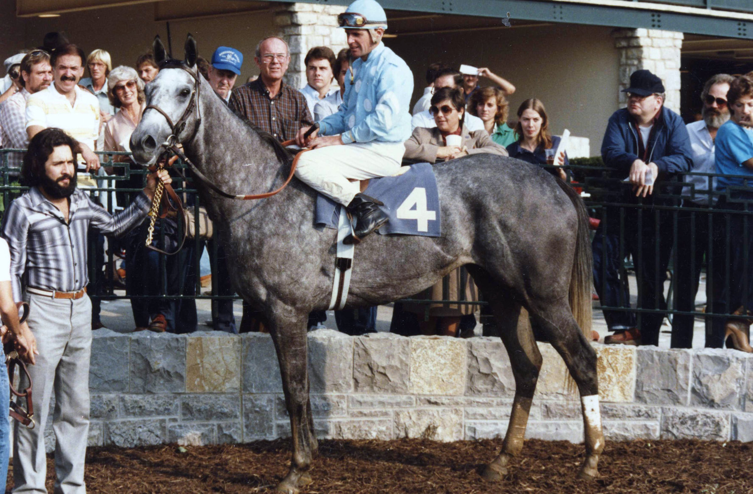 Eddie Delahoussaye and Princess Rooney in the winner' circle at Keeneland in 1984 (Barbara D. Livingston/Museum Collection)
