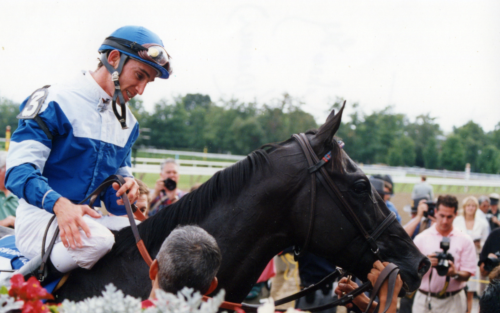 Ramon Dominguez in the winner's circle for the 2004 Sword Dancer at Saratoga (Mike Pender/Museum Collection)