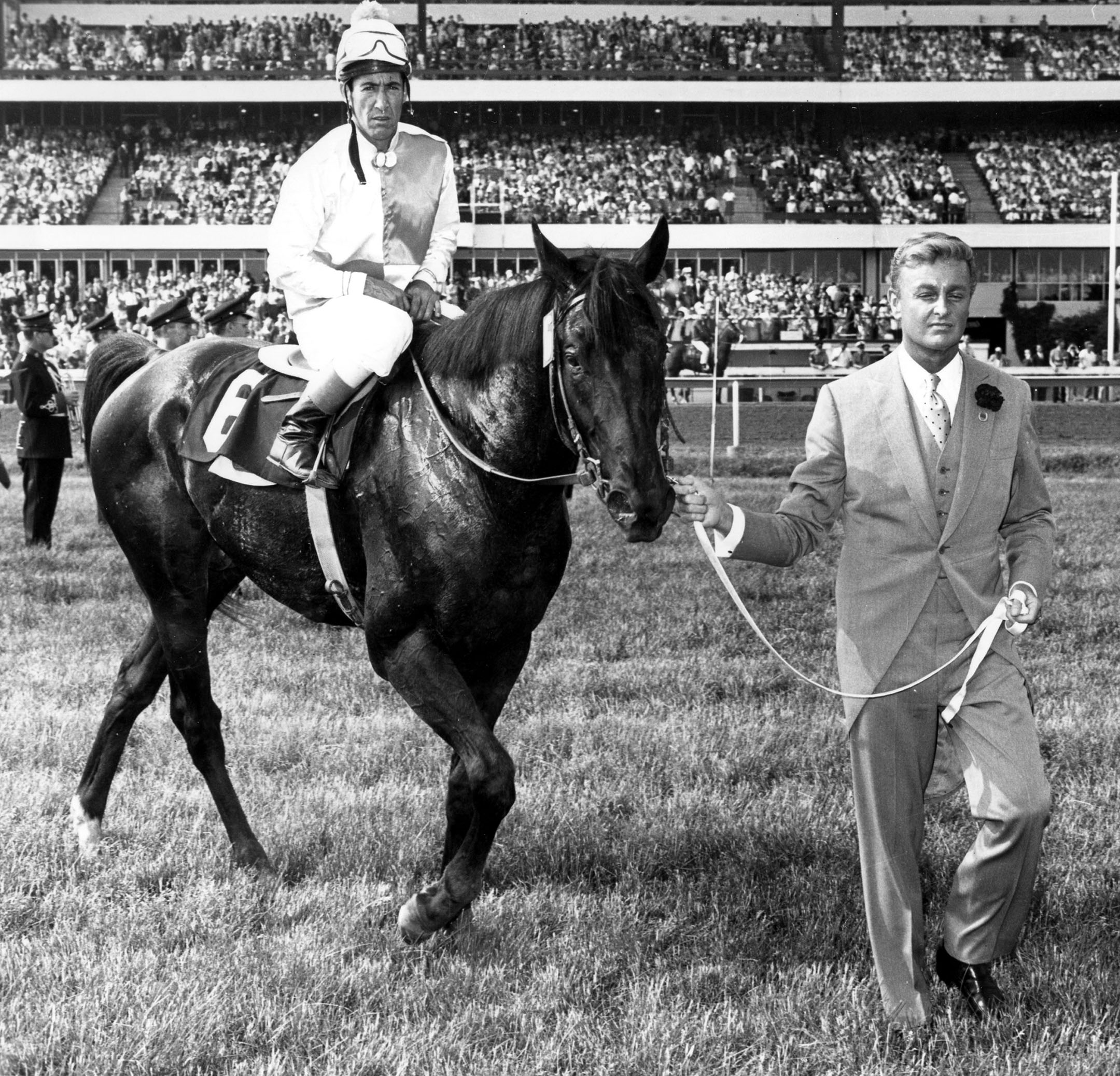 Avelino Gomez and Titled Hero enter the winner's circle after winning the 1966 Queen's Plate at Woodbine (Michael Burns/Museum Collection)