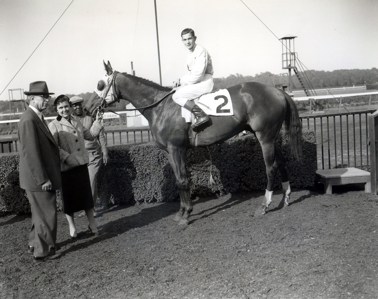Bill Hartack and Dedicate in the winner's circle after winning the 1957 Woodward at Belmont Park (Keeneland Library Morgan Colleciton/Museum Collection)