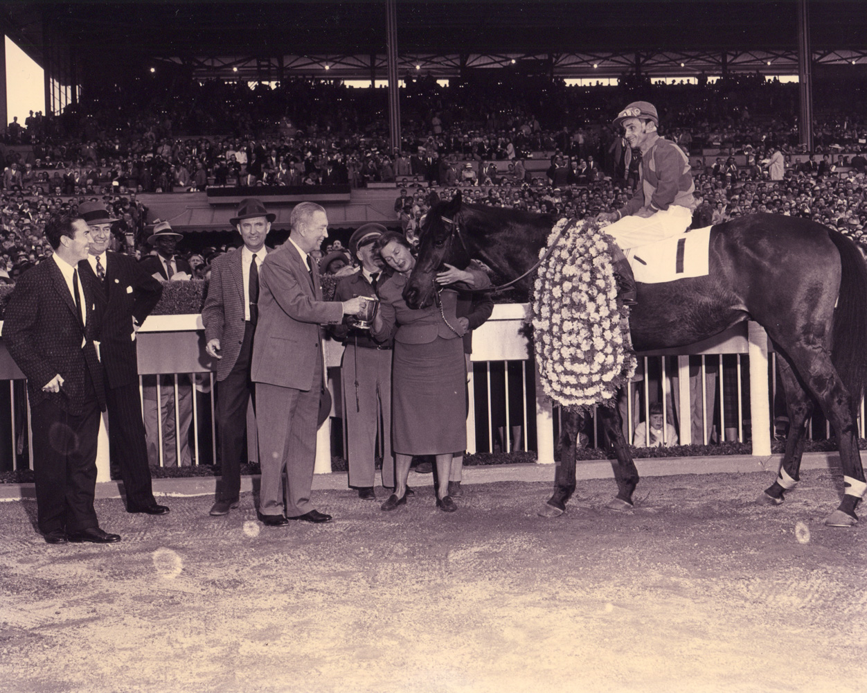Ralph Neves and Cornhusker in the winner's circle for the 1957 Santa Anita Handicap (Santa Anita Photo/Museum Collection)