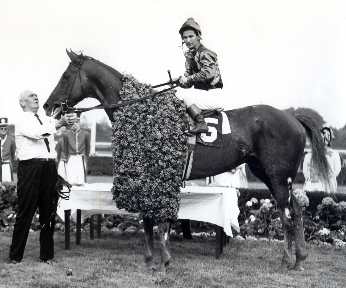 Bill Shoemaker and Candy Spots in the winner's circle after winning the 1963 Jersey Derby at Garden State Park (Museum Collection)