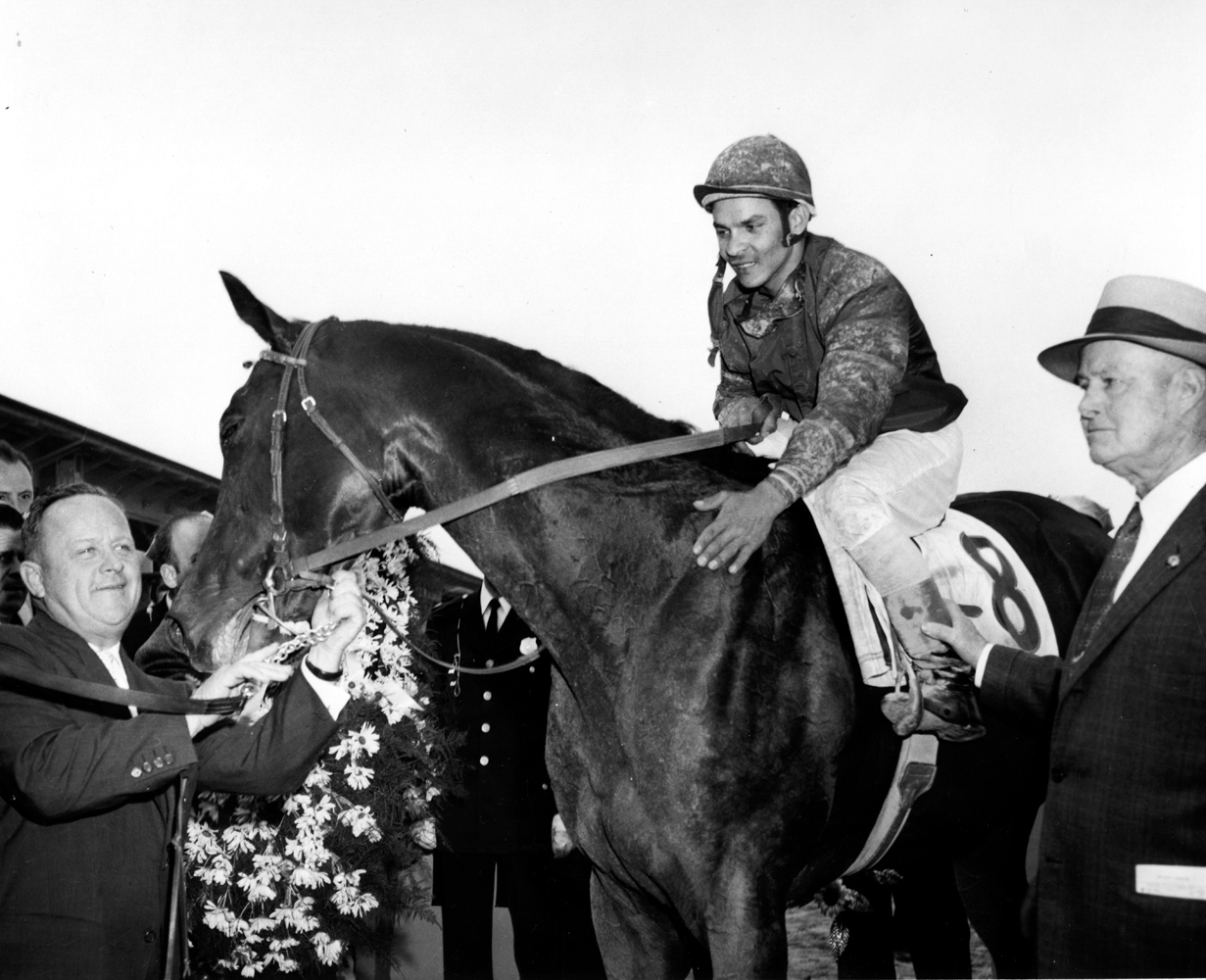 "Milo Valenzuela, Tim Tam, H. A. ""Jimmy Jones, and Ben Jones after their 1958 Preakness Stakes victory (Pimlico Photo/Museum Collection)"