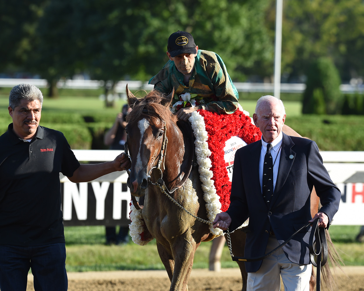 John Velazquez and Code of Honor being led in by William S. Farish III after winning the 2019 Travers Stakes (NYRA)