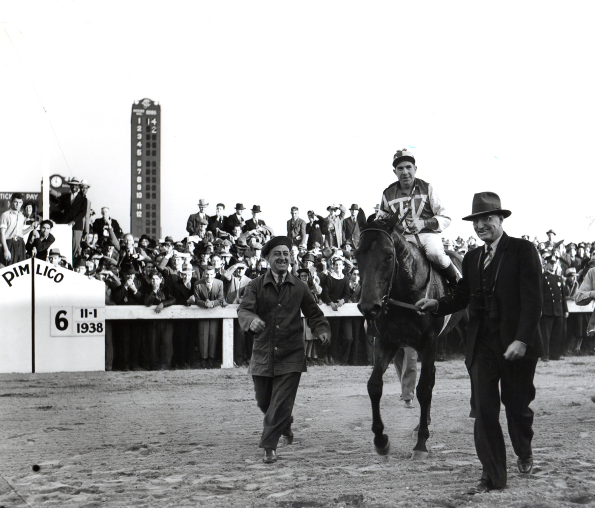 George Woolf and Seabiscuit being led in by trainer Tom Smith after defeating Triple Crown winner War Admiral in the 1938 Pimlico Special match race (Keeneland Library Morgan Collection/Museum Collection)