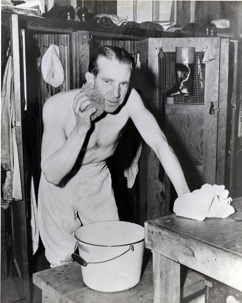 George Woolf in the locker room between races (Museum Collection)